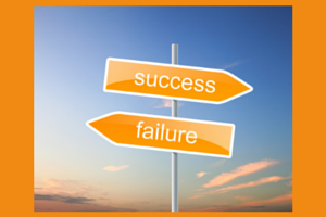 Two direction signs on a post, one says success the other says failure