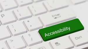An image of a green Accessibility keyboard button.