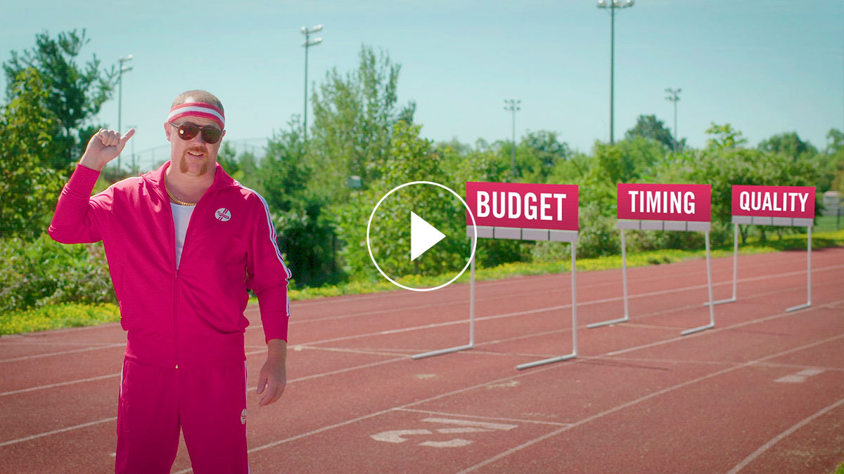 A man in a pink track suit in a running track field